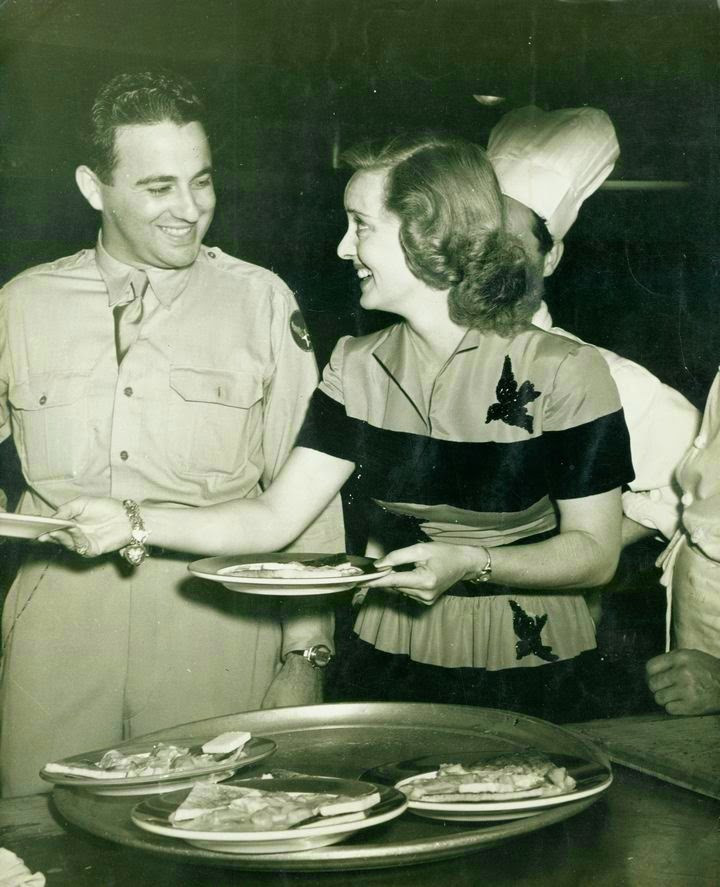 Bette Davis serving at Hollywood Canteen
