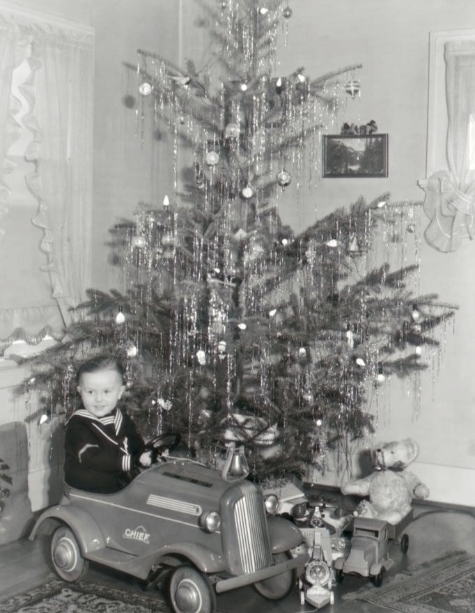 1930s Christmas. Little boy and thirties Christmas toys.