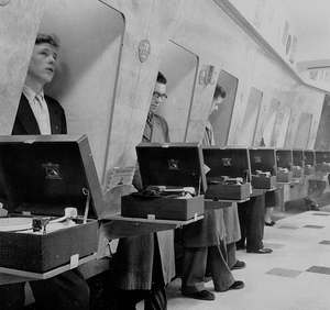 Listening to records in records store 1960's