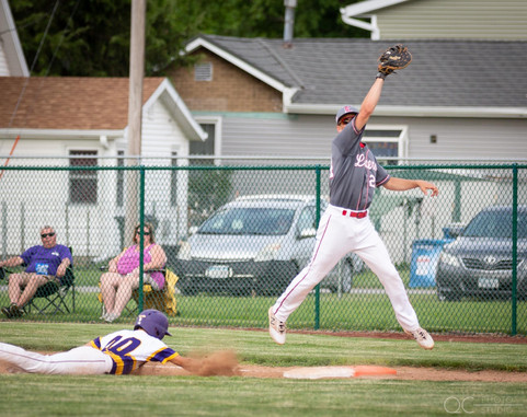 First Baseman Jumping to Catch Ball