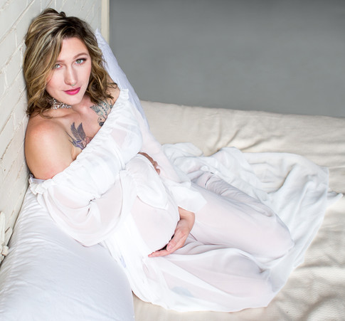 Pregnant Mom Lying In Bed