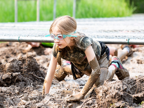Girl-With-Goggles-Crawling-Mud-Race.JPG