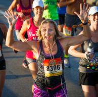 Hands Up Female Marathon Runner