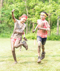 Muddy-Girls-Fist-Pump.JPG