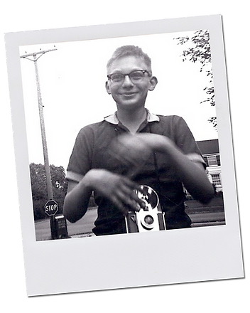 Polaroid photo of young Loren with his camera
