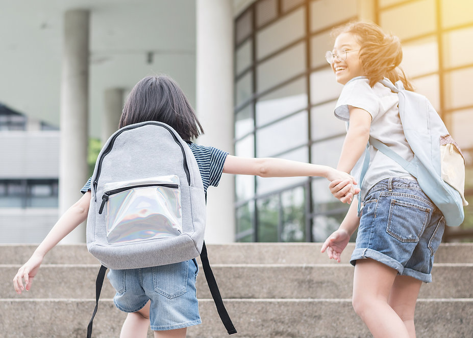 Back to school education concept with girl kids (elementary students) carrying big backpac..., r.jpg