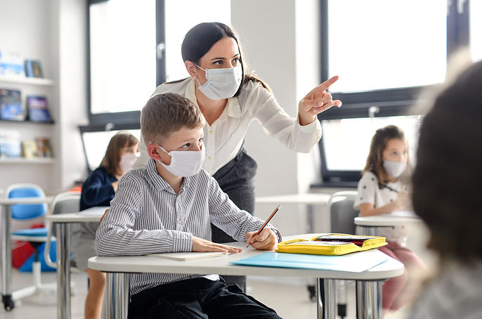 Teacher and children with face mask back at school after covid-19 quarantine and lockdown..jpg