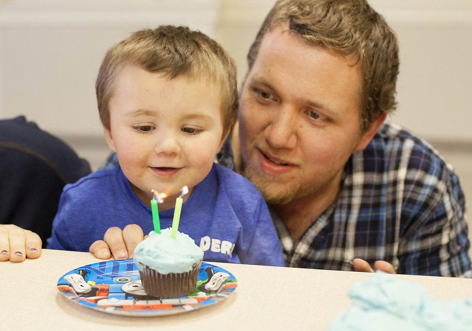 caucasian dad with boy cupcake.jpg