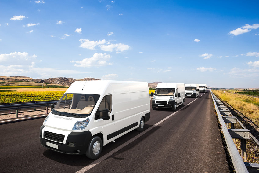 Fleet of White cargo vans driving