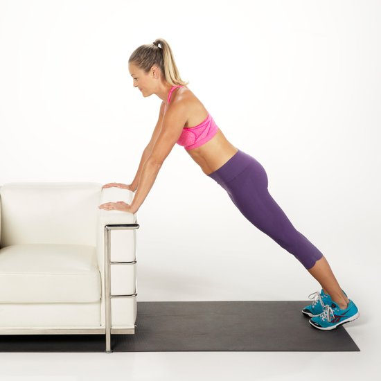 This Incline Push-Up gives you the perfect balance in between a kneeling push-up and a traditional full push-up. Begin in a plank position with your hands on a step or chair against a wall, your shoulders over your wrists, and your body in a straight line. Bend your arms and lower chest to the chair making sure to keep your body in a straight line. Press body back to plank as you exhale. Repeat to perform as many as possible.