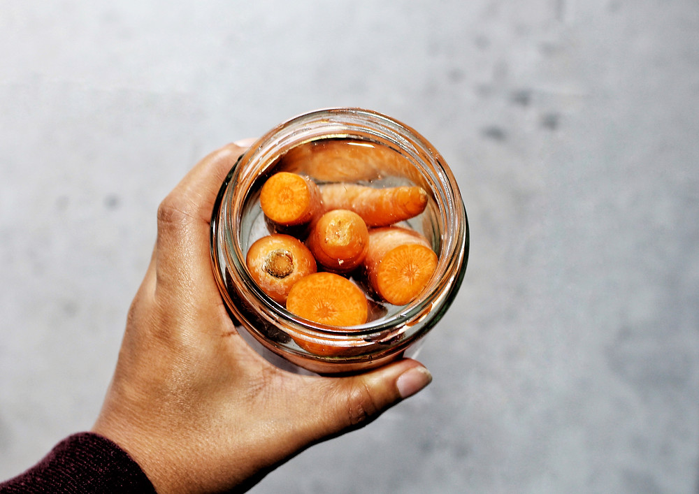 Carrots stored in a glass container. Plastic and chemical free solutions for storing food for balanced hormones. Photograph by You Need A Nutritional Therapist Ltd.