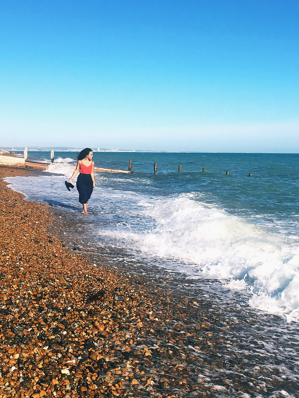 Kay Ali by the coast. Hormone and mental health expert and co founder of You Need A Nutritional Therapist. Kay Ali discusses how being in nature supports health and wellbeing.