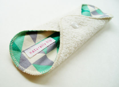 Hemp fleece cloth menstrual pad with turquoise and gray triangle pattern cotton