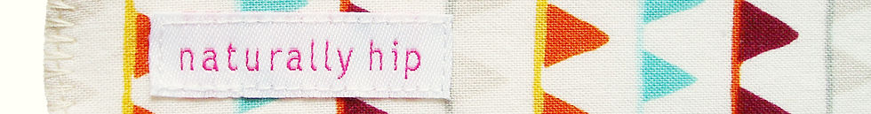 Cropped image of handmade cloth menstrual pad, with label reading Naturally Hip