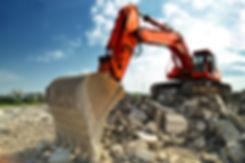 Crawler excavator on demolition site. Fr