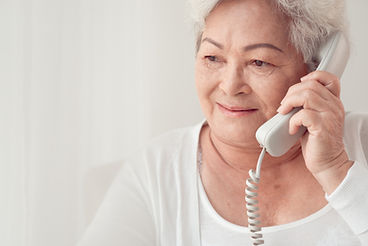 Senior woman holding telephone.
