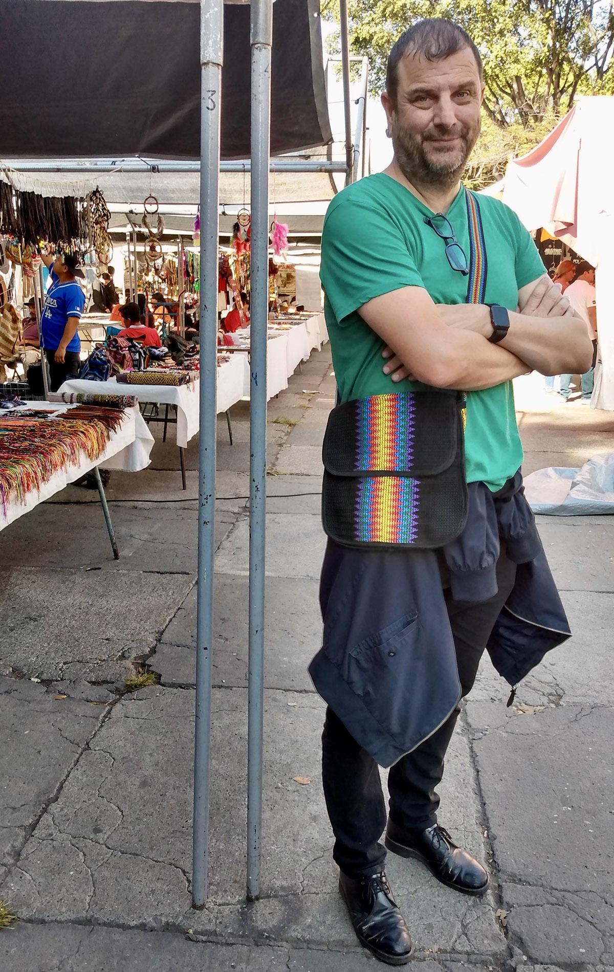 tianguis cultural flea market man with bag