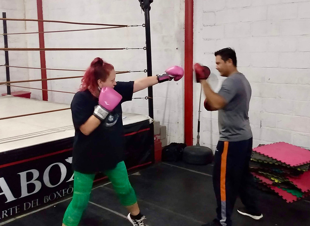woman and man boxing