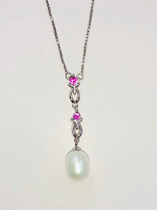 White Freshwater pearl, set on Sterling Silver, encrusted with 2Real Rubies