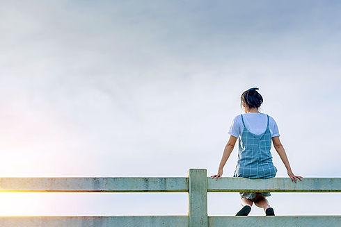 woman_sitting_fence_adobe1-600x400.jpg
