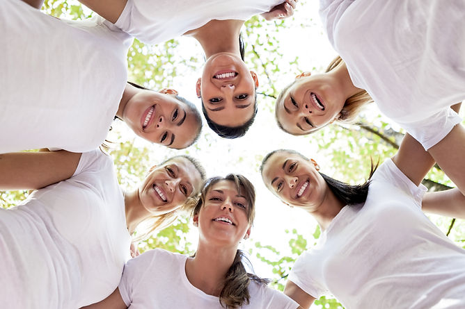 Group of women standing in the circle, s