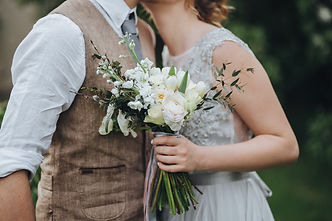 The bride in a white dress and groom in