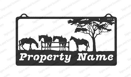 Horses under Tree Farm Sign