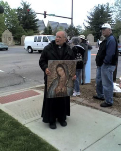 Father Weslin on  a another tireless  rosary marches 3.jpg