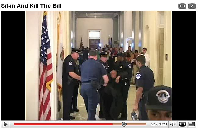 Father Weslin tearing up Obamacare Bill in Nancy Pelosi, later he was arrested.j