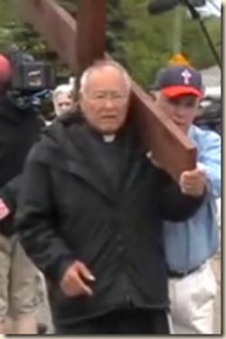 Fr Arrested in protest.png