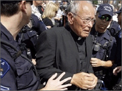 Father Weslin Arrested again for Praying the rosary.jpg