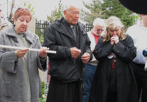 Father Weslin Praying in front of Notre Dame.jpg