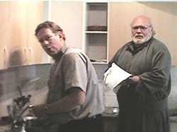 Father Tom and I doing cleaning up