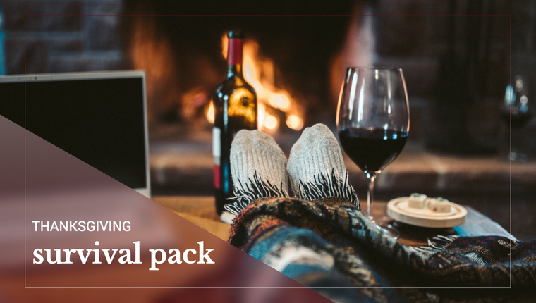 Thanksgiving survival guide post with cozy socks, wine, and a fire for Fall or winter