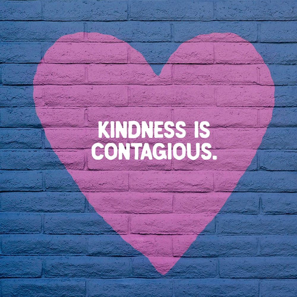 Kindness is contagious social media post template with a purple heart on a blue brick wall