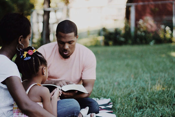 black-family-dad-reads-bible.jpg