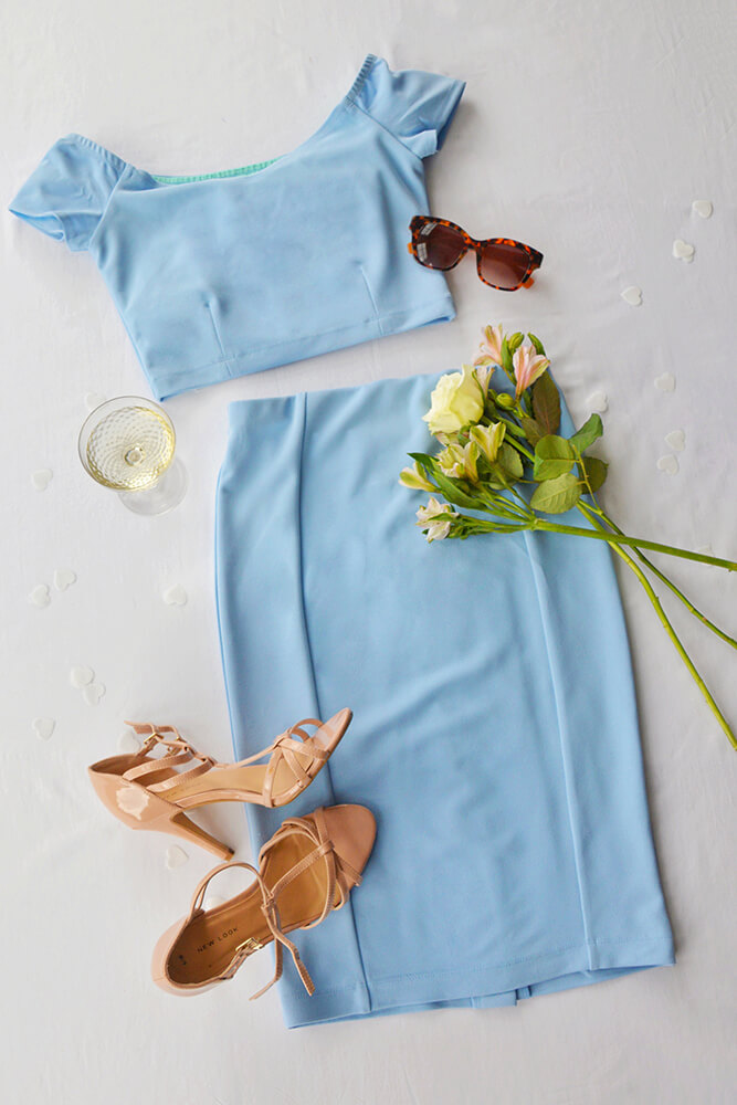 Soft pastel blue is such a flattering colour for most, feeling especially elegant for summer in this off shoulder design.  Finish the look off with some Audrey Hepburn sunnies for some extra glamour!