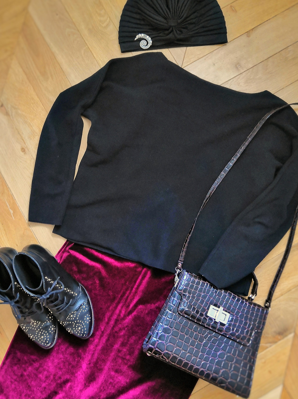 Vintage inspired flatlay outfit with boots, bag, sweater and velvet pencil skirt