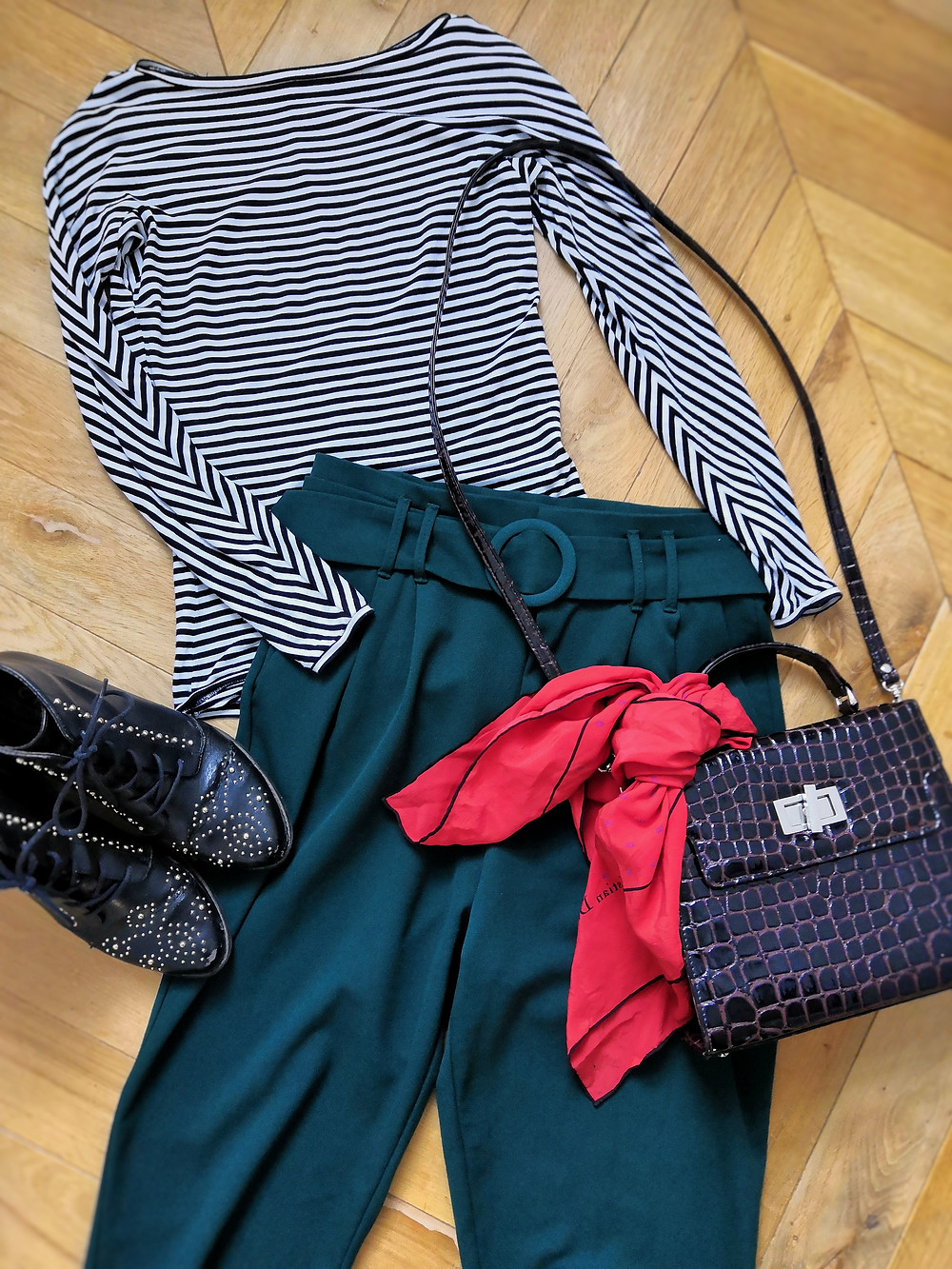 Flatlay outfit with stripy bodysuit, trousers, bag, scarf and boots