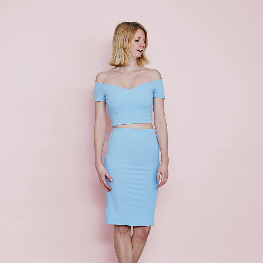 With off shoulder top and pencil skirt in pastel blue