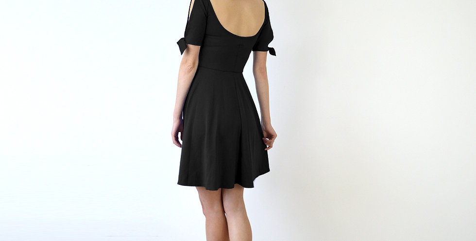 Nanette Wide Neck Scoop Skater Dress in Black full back view
