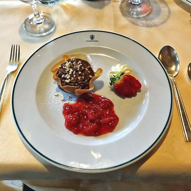 Indulgent chocolate mousse with a strawberry coulis