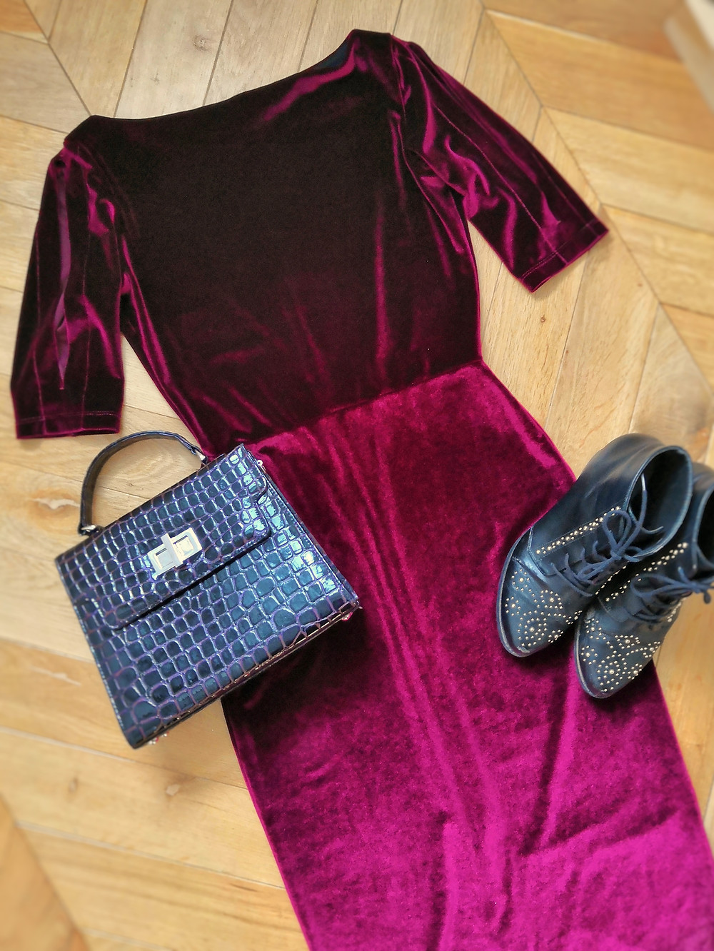 Vintage inspired flatlay outfit with velvet dress, boots and bag