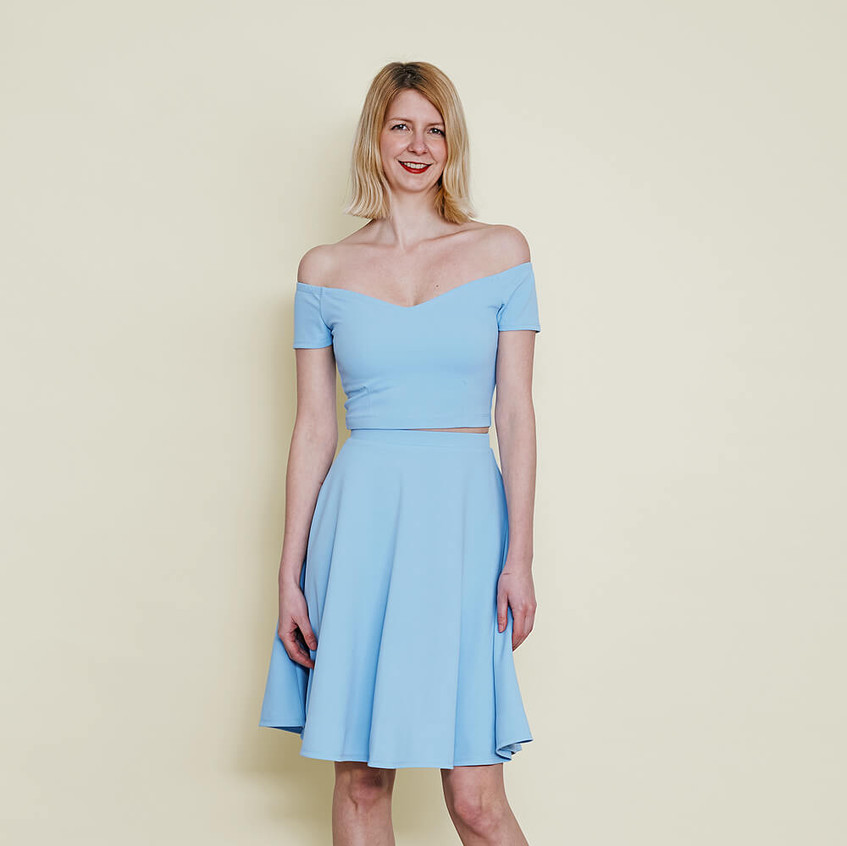 With off shoulder crop top and skater skirt in pastel blue
