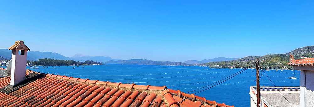 Vista overlooking the sea and mountains from Poros town