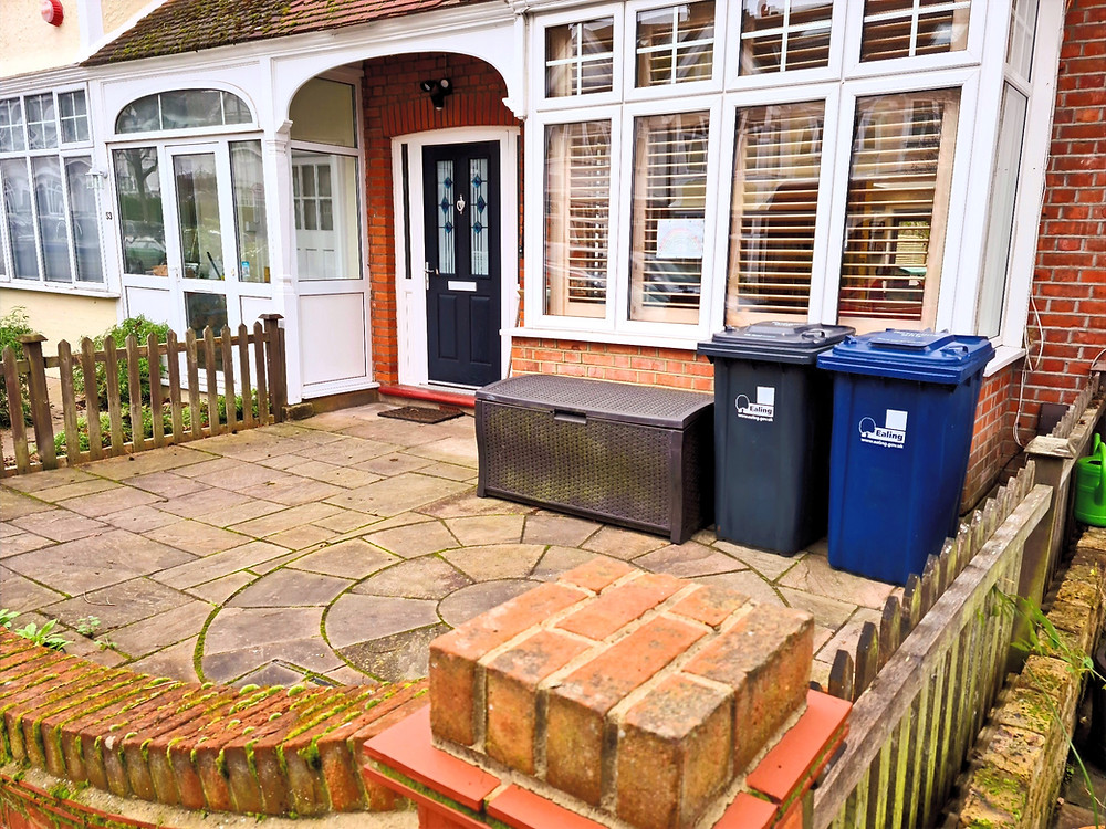 Contemporary Tiled Front Garden with Bike Storage