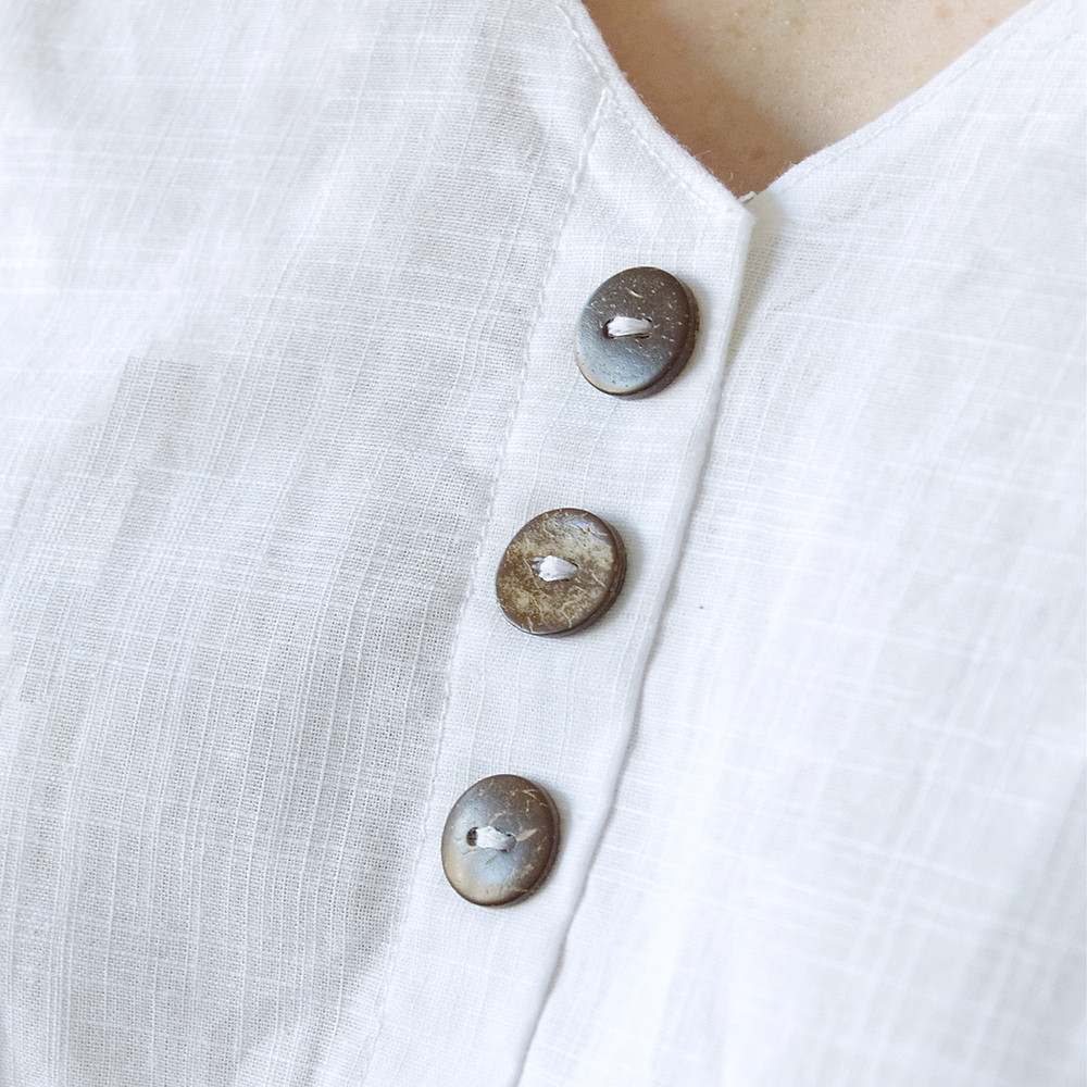 White linen-style weave cotton fabric and coconut buttons