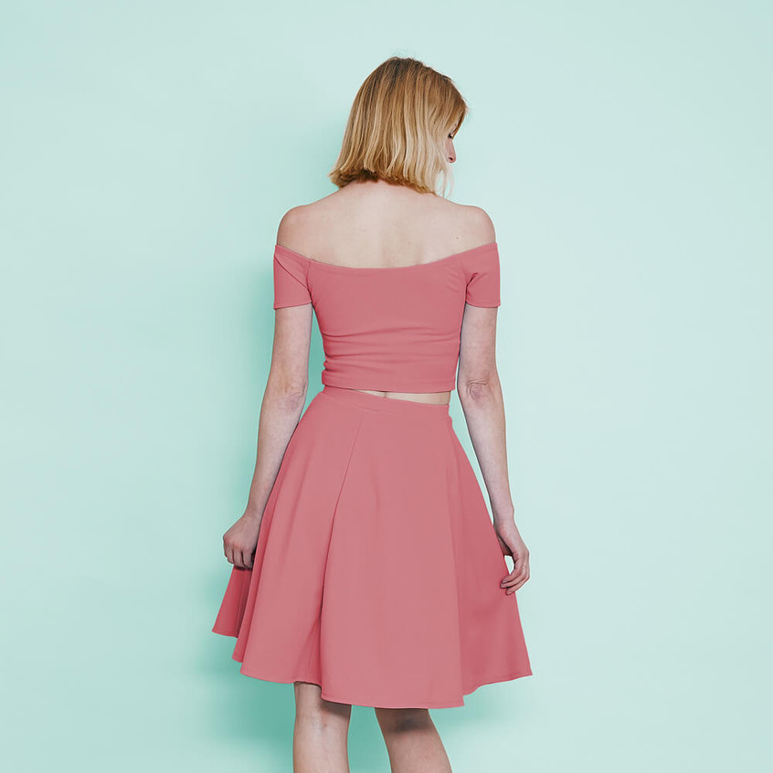 With off shoulder crop top and skater skirt in pastel pink