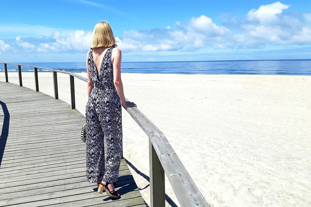 Marlene printed beach pyjama jumpsuit overlooking the beach