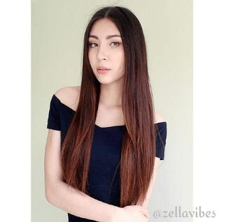 Zella looks amazing in her black Bardot dress - photo c/o customer